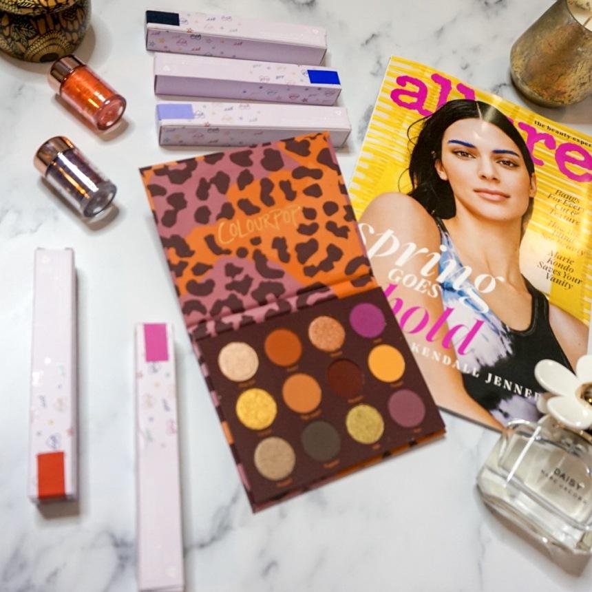 ColourPop BFF Mascaras, Zodiac Loose Pigments, and Good Sport Eyeshadow Palette Flat Lay